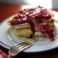 Lemon Poppyseed pancakes with raspberry sauce