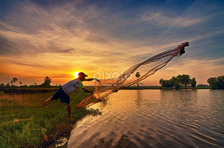 Fishing time! by Ravuth Um - People Street & Candids ( sunset, lanscape, lake, fishing, alone, man )
