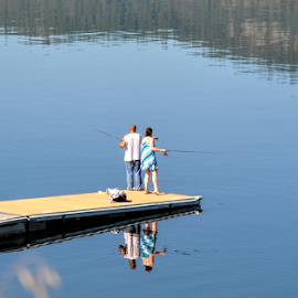 Fishing Couple by Keith Sutherland - People Couples ( reflection, lake, couple, fishing, dock )