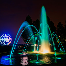 Ferris Wheels and Fountains by Deborah Felmey - Landscapes Travel ( water, fountains, night, landscape, ferris wheel )