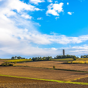 Look ! A Tractor ! by Marcel de Groot - Landscapes Mountains & Hills ( clouds, paths, blue, white, lines, yellow, landscape, path, nature )