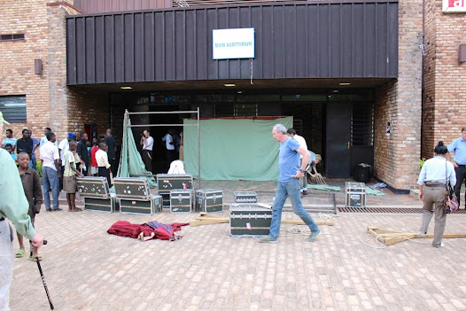 Stage Manager Dave McEvoy works with the company to re-assemble the set outside. The entire move took less than 25 minutes.