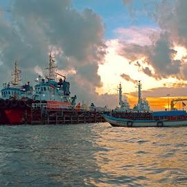 sunset in nusakambangan island by Fendi Hermawan - Transportation Boats
