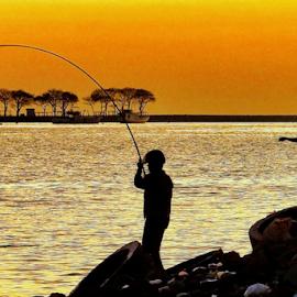 Fishing at Dusk by Hendra Poerwita - People Portraits of Men ( beaches, sunset, harbour, fishing, dusk, man )