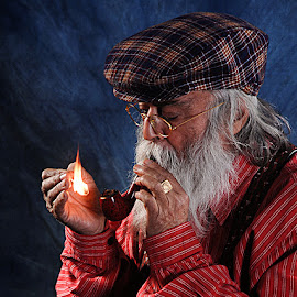 Lighting his pipe.. by Rakesh Syal - People Portraits of Men (  )