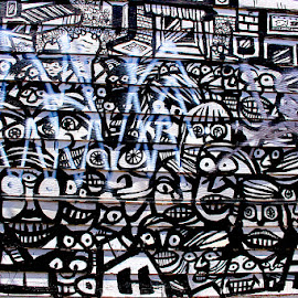 Faces by Ronnie Caplan - City,  Street & Park  Neighborhoods ( streetscene, patterns, facses, graffiti, lines, mouths, wall, eyes )