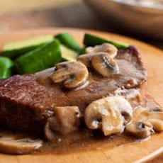 Swanson® Pan-Seared Steaks with Mushroom Gravy