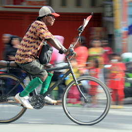 i was ride bicycles by Boby Absalom - Transportation Bicycles ( panning, travel, transportation, people, bicycle )
