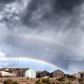 After the storm by Sue Niven - Landscapes Weather ( boat sheds, storm clouds, landscape, rainbow, dorset )