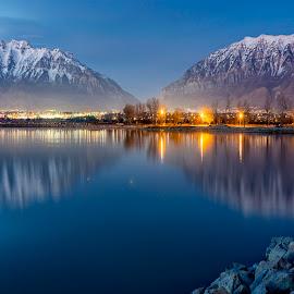 by Lee Cuellar - Landscapes Mountains & Hills ( water, mount timpanogos, waterscape, timpanogos, reflections, lake, utah lake, city, mountains, utah, state park, trees, rocks, lighs )