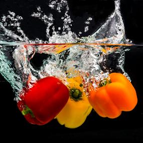 Uno Dos Tres Salto by Avi Chatterjee - Food & Drink Fruits & Vegetables ( orange, organic, red, splash, fresh, motion freeze, pepper, yellow )