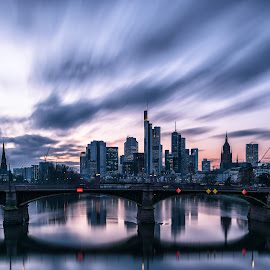 Clouds over Skylines by Selman Dogan - City,  Street & Park  Skylines ( clouds, skyline, reflection, reflections, cityscape, main, city, lights, frankfurt, sky, skyscraper, wolken, long exposure, bridge, mainhattan, light, river )