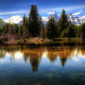 Clear Reflections by John Larson - Landscapes Mountains & Hills ( water, mountains, blue sky, wispy clouds, nature, snow, reflections, trees, forest, river bottom rocks,  )