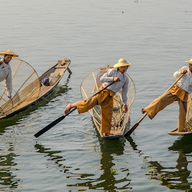 The Trio Rowers by Khun Myo Than Htun - People Professional People ( leg rowers, shadow, silhouette, boats, shade, people )