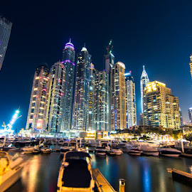 Dubai Marina by Sajeesh Kumar - City,  Street & Park  Skylines ( canon, skyline, skyscrapers, boats, tallest, lights, twisted, 7d, dubai, night, long exposure, marina, wharf )