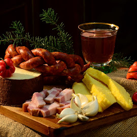 Romanian Christmas traditionals by Delia Cozma - Food & Drink Plated Food ( wine, wood, garlic, mamaliga, christmas, little, bacon, chopper, cheese, yellow, chili, wood chopper, polenta, sausages, red, food, drink, smoked bacon, pine branch, glass, branch, pine, carnati )