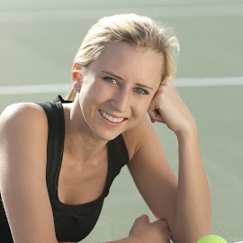 Smiling Tennis player laying on the court. by Matt Paepke - Sports & Fitness Tennis ( fitness, female, woman, exercise, tennis, smiling, athletic )