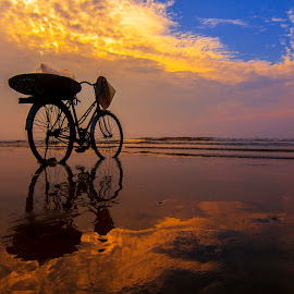Alone by Amateur Pic - Transportation Bicycles ( reflection, sky, bike, sunset, sea, vietnam, beach, sunrise, amateurpic )
