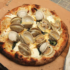 Pizza with Fresh Clams, Garlic, Mozzarella, Romano, and Basil jkla