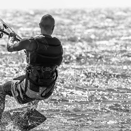 Kiting into the Sun by Jason Rose - Sports & Fitness Watersports ( kiting, kite boarding, fiji, nananu-i-ra, safari resort )