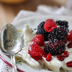 Vanilla Bean Pavlova with Honey Cream and Berries
