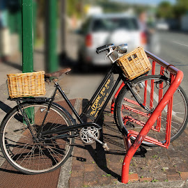 delivery bike by Vibeke Friis - Transportation Bicycles ( bike stand, old, bike, baskets, delivery, , Bicycle, Sport, Transportation, Cycle, Bike, ResourceMagazine, Outdoors, Exercise, Two Wheels )