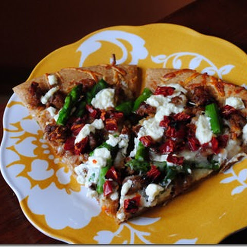 Spicy Sausage and Sun Dried Tomato Goat Cheese Pizza