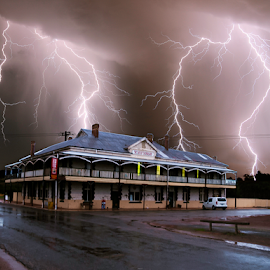 Remote town strikes by Craig Eccles - News & Events Weather & Storms ( thunder, lightning strike, lightning, lightning bolt, thunder storm, remote, town, thunder bolt, pub, weather. )