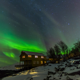 House under attack from Aurora by Geir Hammer - Buildings & Architecture Homes ( water, stars, green, northern lights, snow, aurora borealis, trees, house, norway )