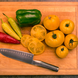 Served by Keith Homan - Food & Drink Fruits & Vegetables ( wood, tomato, slices, pepper, yellow, rare, ingredient, knife, top, preparation, green, vegetables, cutting, culinary, kitchen, board, tomatoes, dinner, freshly, wooden, red, food, blade, healthy, cut, view, vegetable )