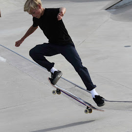 The Arrow by Shawn Taylor - Sports & Fitness Skateboarding ( skateboarding, blond, boy, skateboard, jump )