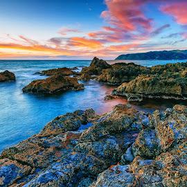 Light Dancing On The Water by Stewart Baird - Landscapes Sunsets & Sunrises ( clouds, waves, sunset, sundown, sea, www.stewartbaird.com, sxbaird, long exposure, stewart baird, titahi bay, landscape, new zealand )