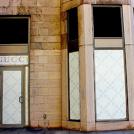 Gucci by Ronnie Caplan - City,  Street & Park  Markets & Shops ( sign, logo, gucci, patterns, store, boarded up, door, bricks, closed, storefront, entrance, abandoned )