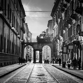 Time Lingers by Daniel  Barbosa - City,  Street & Park  Street Scenes ( torino, arches, black & white, italy, street photography )