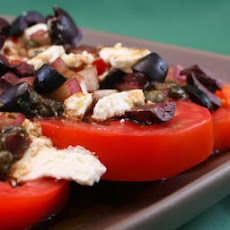 Sliced Tomato, Olive, and Goat Cheese Salad with Onion-Caper Vinaigrette