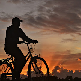 by Yudi Dhaniwanto - Transportation Bicycles ( sunset, man, bicycle )