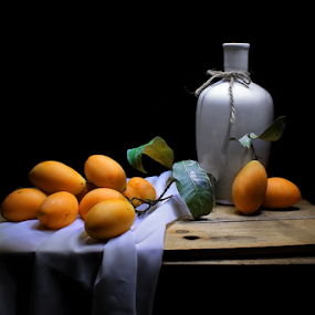 Kundangs by Suehana SuZie - Artistic Objects Still Life ( orange, light painting, still life, art, fruits, fine art, dark background,  )