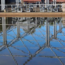 Bench by Ólafur Ingi Ólafsson - City,  Street & Park  City Parks ( reykjavík, water, reflection, iceland, bench, pool, tentpol, reflections, rock, rocks )