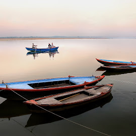Boats on the Ganges in Varanasi, India by Greg Gibb - Landscapes Travel ( serene, sunset, boats, ganges, india, varanasi, meditate, holy, travel, glow )