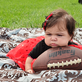 Ready for some football? by Joshua Moritz - Babies & Children Babies ( ball, red, season, football, laying, baby, portrait, black )