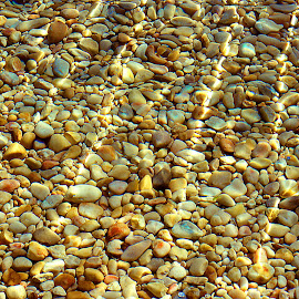 REFLECTIONS IN STONE by Walter Carlson - Abstract Patterns ( water, reflections, travel, beach, stones )