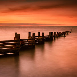 Sunset Reflection on Still Waters by Jan Murphy - Landscapes Sunsets & Sunrises ( water, tranquil, groyne, red, relax, sunset, long exposure, tranquility, relaxing )