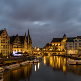 Fairy-tale Ghent by night, Belgium  by Siniša Ciglenečki - City,  Street & Park  Night ( illuminated, old, stone, house, architecture, cityscape, people, attraction, city, gent, sky, bank, church, belgium, tourism, postcard, dusk, landmark, tourist, winter, european, facade, window, outdoors, bridge, view, town, port, europe, reflections, panorama, lights, life, monument, evening, fairytale romantic leie urban, ghent, nightlife, water, building, beautiful, christmas, traditional, canal, talking, tower, blue, night, historical, channel, medieval, river,  )