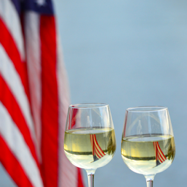 Stars and Stripes by Judy Tomlinson - Artistic Objects Still Life ( reflection, flag, new york usa, autumn, wine glass, stars and stripes, lake seneca, watkin's glen, star spangled banner, finger lakes )