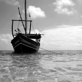 Anchored by Werner Booysen - Transportation Boats ( dhow, blackandwhite, waterscape, black and white, sea, ocean, seascape, boat, werner booysen,  )