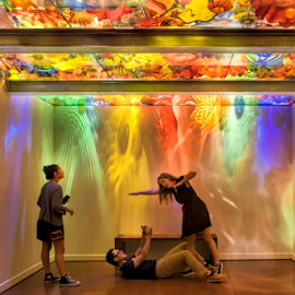 Playing at the Chihuly Gallery by Phyllis Plotkin - Artistic Objects Other Objects ( playing, colored wall reflecftions, taking a shot, posing, ceiling sculptures )