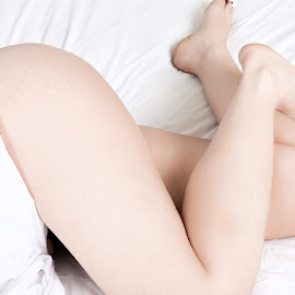 Legs by Lawrence Burry - Nudes & Boudoir Boudoir ( sexy, red toe nails, bare ass, bedroom scene, bare legs, provocative, middle aged model, bare butt, white sheets, bare buttocks )