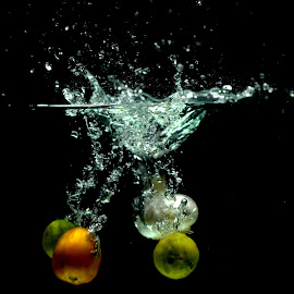2 limes, a tomato and garlic dive in by Aditya Kristianto - Food & Drink Fruits & Vegetables
