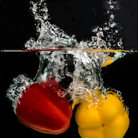 Duology by Avi Chatterjee - Food & Drink Fruits & Vegetables ( time freeze, splash, red and yellow, high sped, experiment, motion freeze, pepper, red. yellow )