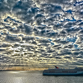 Morning arrival by Gene Myers - Transportation Boats ( clouds, water, shotsbygene, cruise ship, mexico, carnival lines, reflections, morning, sun, gene myers, sky, sunrays, sunrise,  )